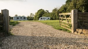 Fully serviced campsite adjacent to the pub with electricity, water, grey and chemical waste and washing area.